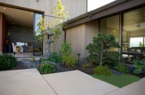 Stylish-Asian-garden-with-compact-design-and-a-stone-lantern-at-its-heart[1]